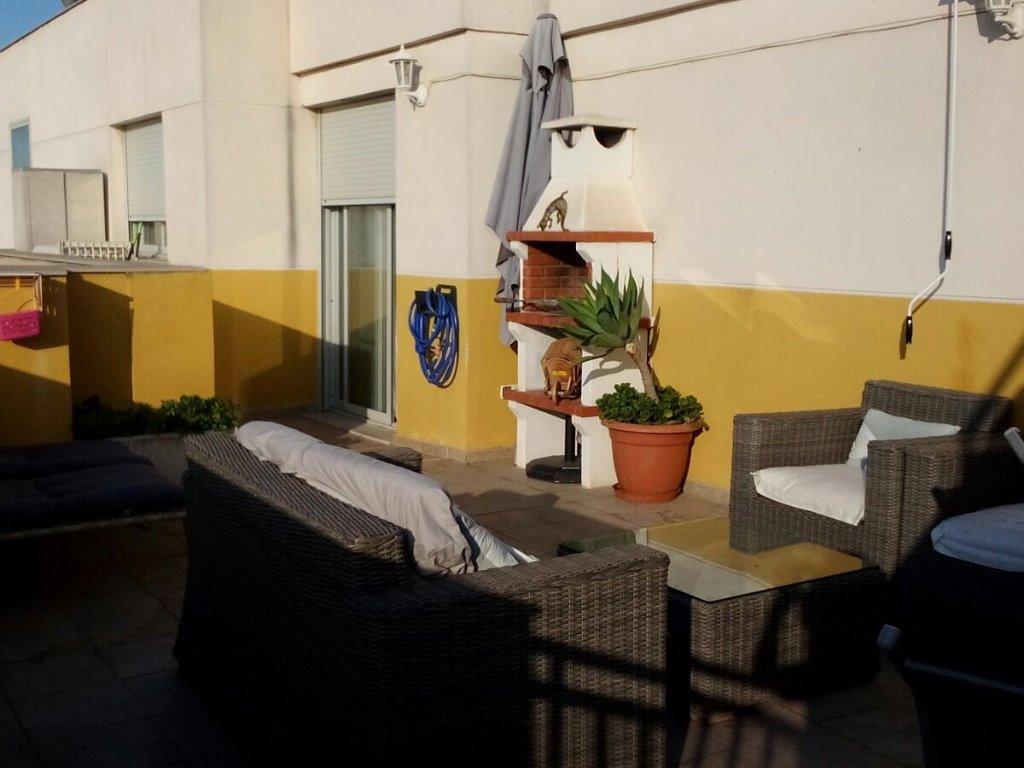 Ático duplex con terraza en planta principal